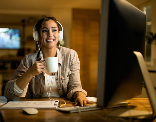 woman working from home, with headphones